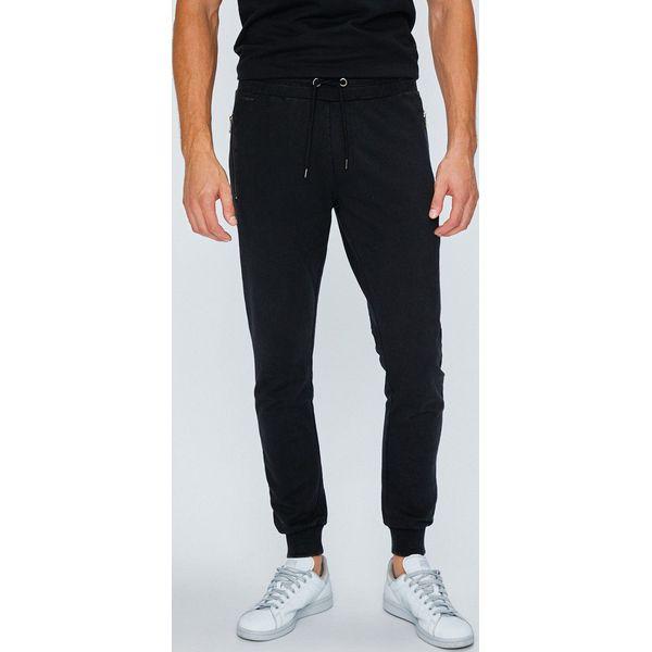 27334cb4c8f7a Guess Jeans - Spodnie - Spodnie materiałowe marki Guess Jeans. W ...